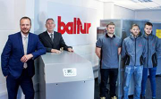 Left to right: EOGB's technical director, Martin Cooke, and managing director, Paul Barritt , with members of the EOGB team in the new Baltur UK showroom.