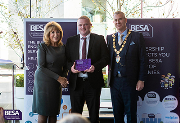 Terence McLaughlin, J S Wright associate director and leader of the J S Wright Experience programme (centre), receives the Employer Training Initiative of the Year Award for London, the South East and the Midlands from guest speaker, author and journalist Eve Pollard and BESA president Tim Hopkinson.