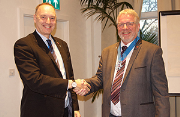 Former IOR president Stephen Gill (left) hands over the baton to Kevin Glass.