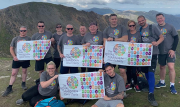 The J S Wright team celebrate at the end of their successful Snowdonia charity challenge: from left to right, back row, Simon Newland, Phil Leech, John Stevenson, Matt Coy, Ryan Quinlan, Gerry Rea, John Heggs, Julie Wilcox, Alan Whyte and Jamie Dove; and front row, Lucy Heggs and Chris Lyons