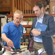 Andrew Hounsfield showing Dr Dan Poulter, MP, around the factory.