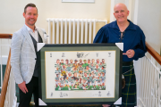 John Savage (left) presents the autographed Celtic print to Danny Byrne.
