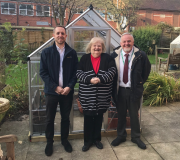 Left to right: Lewis Ronaldson from EnviroVent, with Patricia Harrison, resident of St Mary's Court and Paul Sanderson from Sanctuary Housing, outside the new greenhouse.