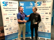 Sidney Copus, 2019 National Winner and gold medalist, being presented with his trophy.