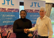 Shaun Donaldson is congratulated on receiving his award by Paul Millington, leader of the J S Wright Apprentice Academy. The presentation took place before the COVID-19 lockdown was announced