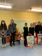 School children receive gifts from Star Refrigeration staff following a company-wide christmas appeal